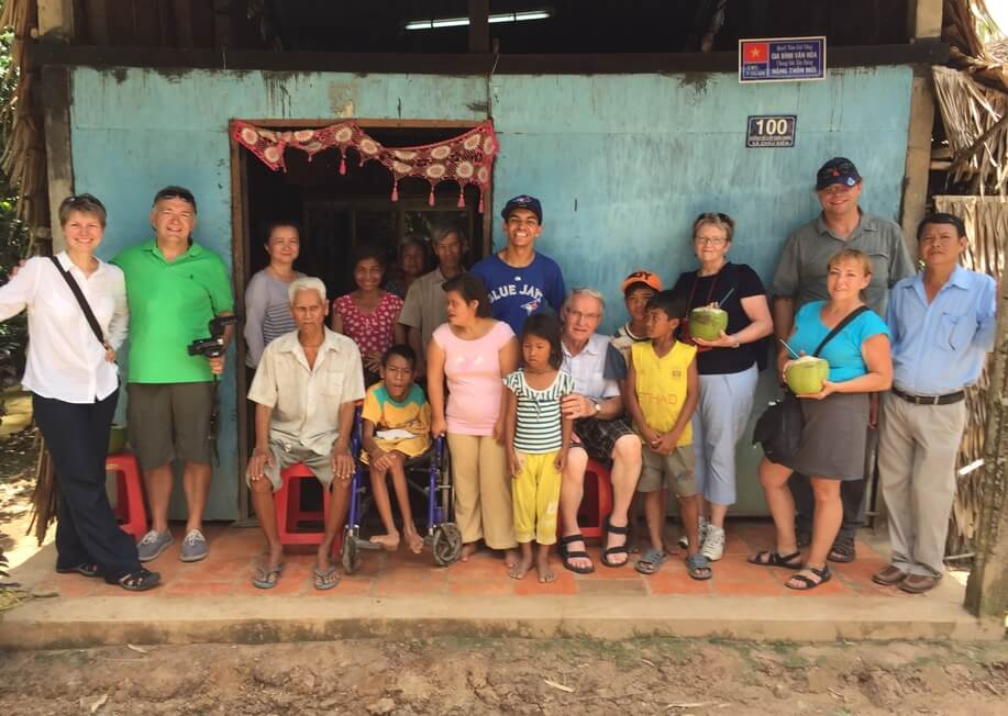 cerebral palsy team for team pic visiting boy with cp in mekong delta vietnam
